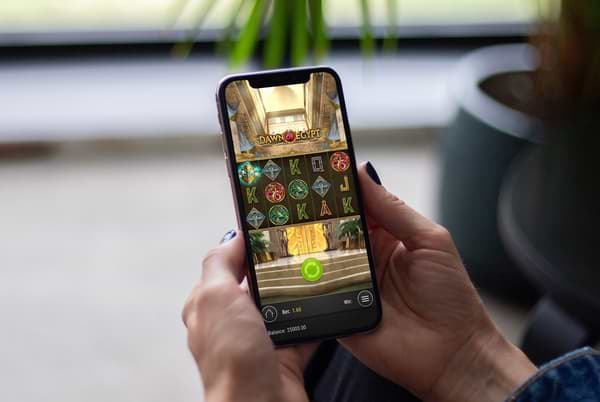 Woman playing Dawn of Egypt on her smartphone